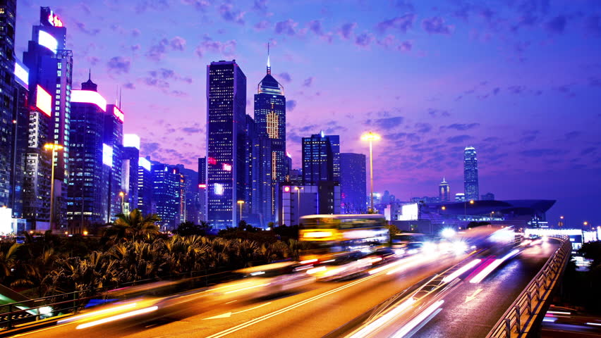 Hong Kong City Night Timelapse. Zoom Out from office buildings. City timelapse shot of office buildings under fast moving cloud at night. Busy cars on highway at rush hour. | Shutterstock HD Video #5609054