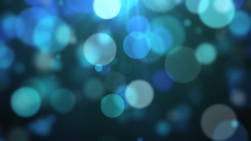 A beautifully animated video background of slowly moving particles.