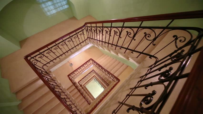 Stock video of top view square spiral staircase with ...
