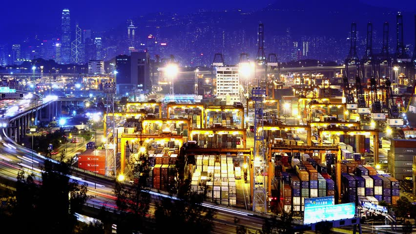 Containers Port Timelapse at Night. 4K Hong Kong. Tight Static Shot. Cargo containers loading activities in cargo terminal. Office buildings at the back. Busy traffic on the main road at rush hour.  | Shutterstock HD Video #5633354