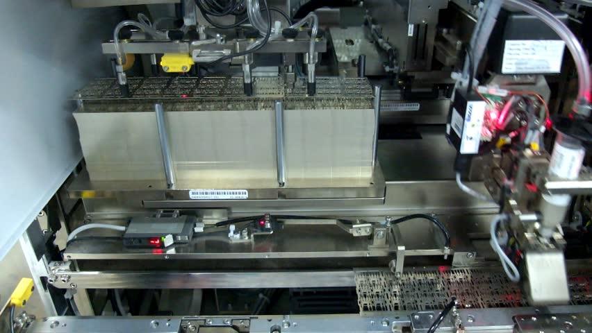 Automated machine picking leadframe module production,IC,factory   Shutterstock HD Video #5636174