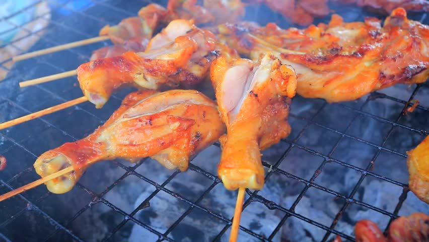 Close up shot of grilling chicken legs | Shutterstock HD Video #5636894