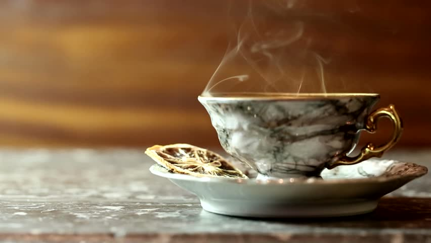 Cup of hot coffee with steam
