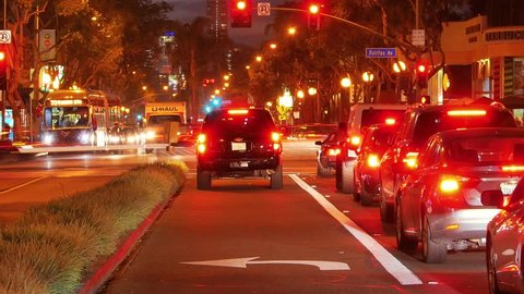 Night traffic on the corner of Santa Monica Blvd and Fairfax Avenue in West Hollywood,California