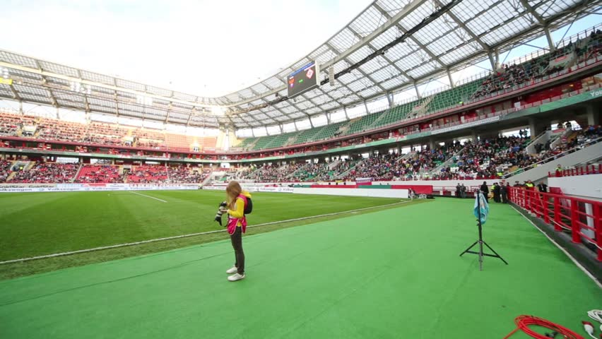 MOSCOW, RUSSIA - SEP 7, 2012: Girl with camera before game Russian team against Northern Ireland on Lokomotiv Stadium. Match ended 2-0 in favor of Russia.