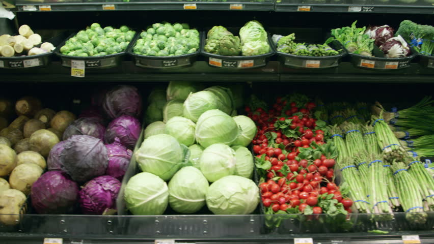 Medium shot moving past fresh vegetables in a supermarket grocery. Includes cabbage, celery, broccoli, lettuce, carrots, corn, onion, etc. Wide shot and close-up of same set-up are in my portfolio. | Shutterstock HD Video #5695409