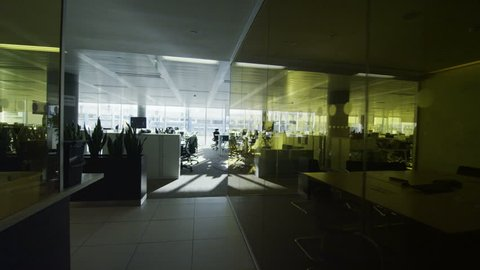Interior view of empty office work stations in a large contemporary city office building. No people.