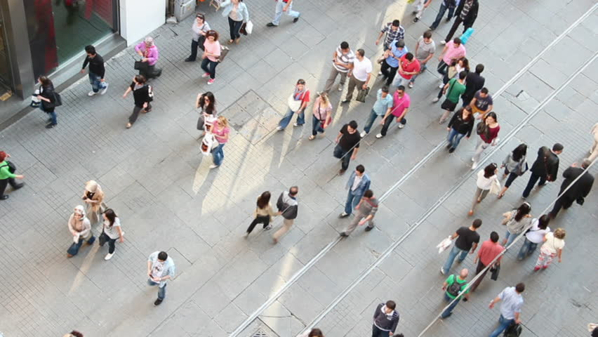 ISTANBUL, TURKEY - MAY 5, 2012: People walking on famous Istiklal street, the most popular touristic and shopping street in Istanbul, Turkey