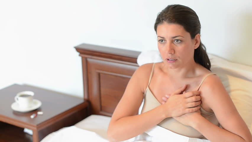 Young sick woman having a heart attack