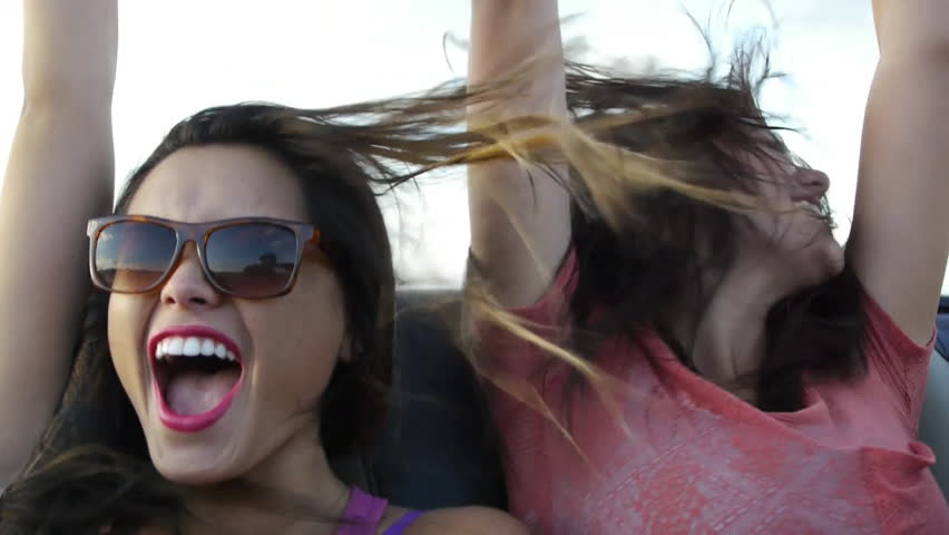Two Friends Scream With Excitement In The Backseat Of A Convertible | Shutterstock HD Video #5734481