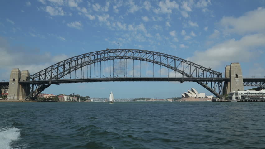 SYDNEY, AUSTRALIA - FEBRUARY 01, 2014: Tracking clip of harbour bridge and opera house