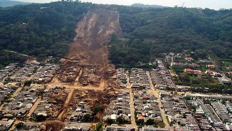 Landslide natural disaster aerial. Perfect for videos about natural disasters, flooding, monsoons, typhoons, mudslides, landslides, nature, disasters, death, suffering, doom, evil, hurricanes
