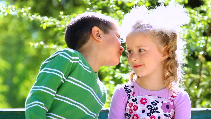 Portrait of little boy kissing pretty girl cute couple in love portrait of little boy kissing pretty girl cute couple in love happy smiling children outdoors green nature background close up of beautiful kids altavistaventures Images