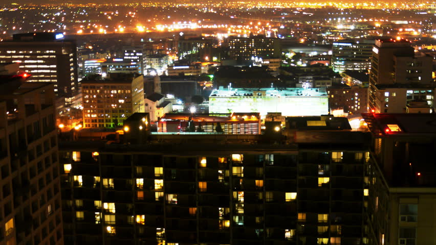 Time Lapse Of Apartment Building At Night Pan Stock Footage