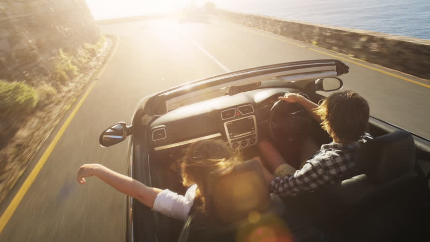 Couple driving convertible car cabriolet cape town south africa steadicam shot with flare | Shutterstock HD Video #5785796