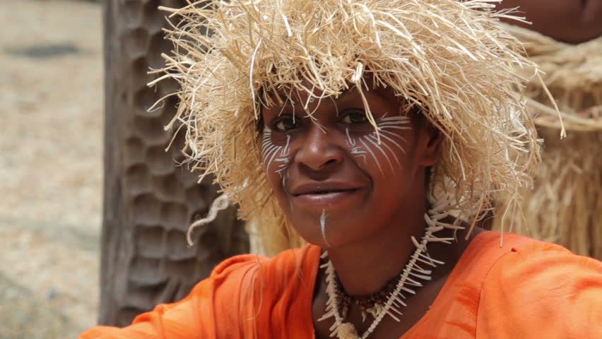 NOUMEA, GRANDE TERRE/NEW CALEDONIA - FEBRUARY 06, 2014: Unidentified Kanak woman of Noumea, New Caledonia posing for tourist photographs