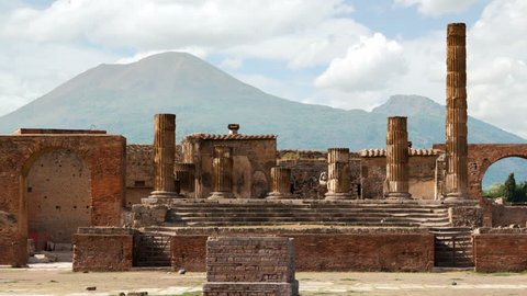 Timelapse of the ruins of Pompei with volcano Vesuvius at back, Italy