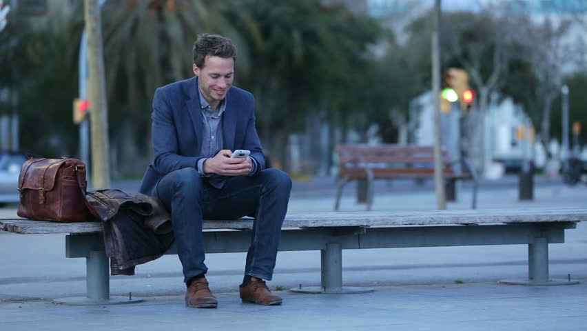 Smart phone man talking and texting in city night using smartphone. Handsome young business man smiling happy wearing suit jacket. Urban male professional in his 20s in Barcelona, Spain. | Shutterstock HD Video #5815826