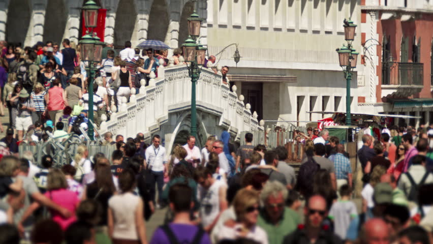 VENICE, ITALY - MAY 2, 2012: Slow motion shot of crowds walking across
