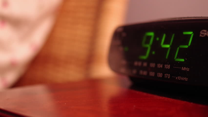 Digital Alarm Clock On A Bedside Table Time Lapse. Stock Footage Video  5824964 | Shutterstock