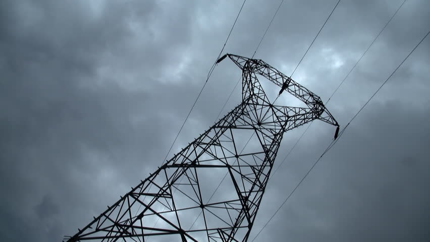 Electricity pylon with stormy sky on the background. Recorded with a Canon Legria HF200