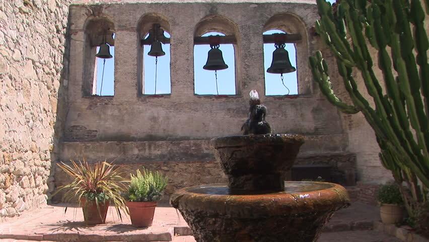 Water fountain and historic bells of San Juan Capistrano