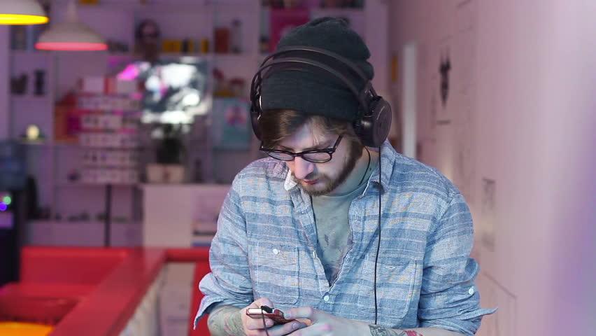 Man listening music wearing headphones choosing tracks songs