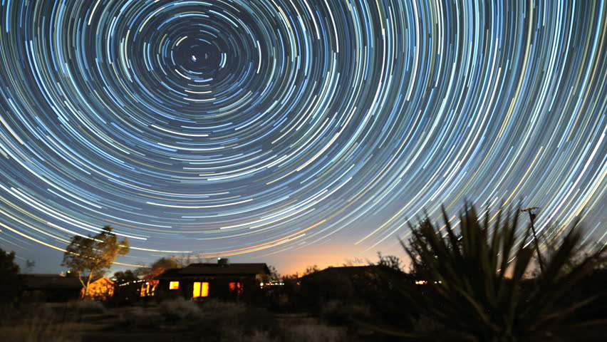4K Star Trails Night Sky Cosmos Galaxy Time-lapse over Cabin. Sunrise from night to day in amazing high resolution at Joshua Tree National Park, California.  #5860994