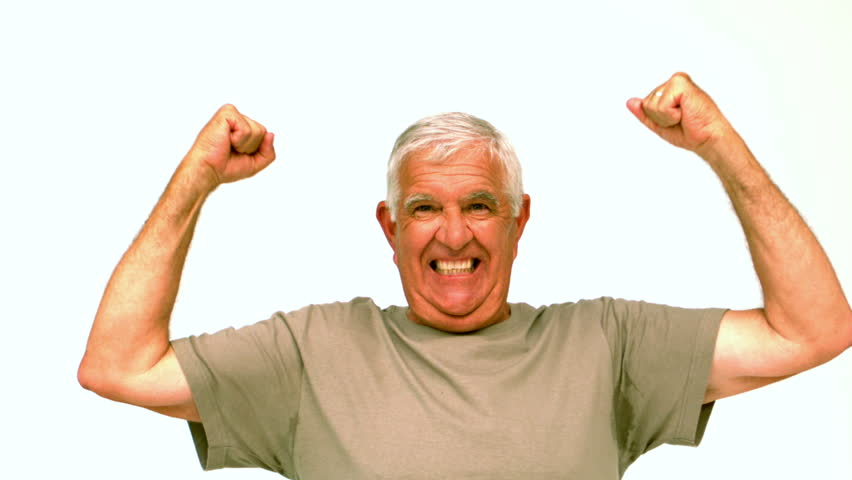 Elderly man jumping and cheering in slow motion