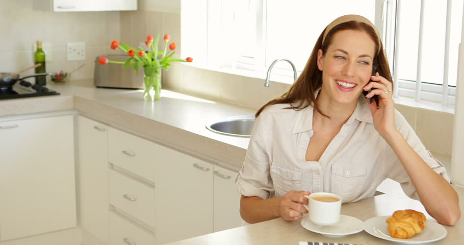 Woman Speaking To The Phone In Her Kitchen Stock Footage Video ...