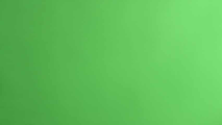 Slating a take with clapper board on green screen, close up