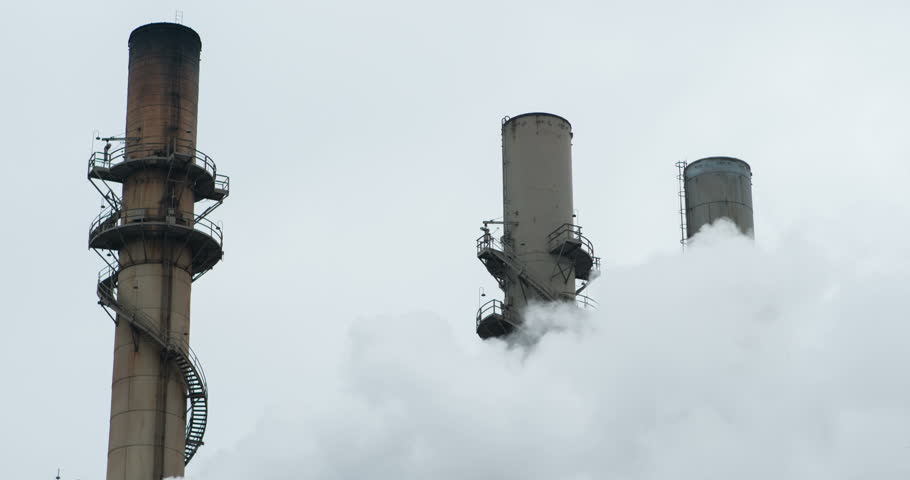 Industrial plant with smoke from production 4k