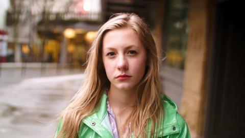 Closeup  Of Serious Teen Girl On A City Sidewalk