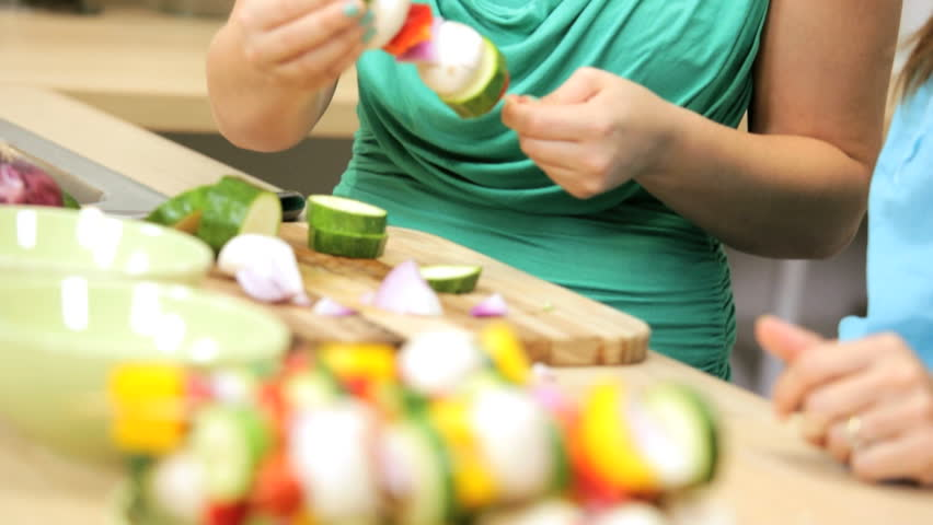 Healthy female Caucasian mother daughters modern home kitchen preparing simple tasty family lunch fresh vegetable kebabs - Caucasian Mom Daughters Preparing Healthy Family Lunch | Shutterstock HD Video #5963864