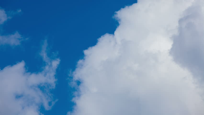 Ultra HD time lapse of white clouds over blue sky #5965004