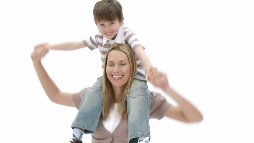 Woman giving little boy piggyback ride and both having fun. Footage in high definition