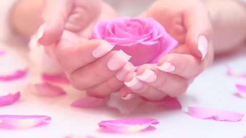 Beautiful woman's nails with beautiful french manicure. Spa hands care. Beauty salon. Slow motion video footage 1080. High speed camera