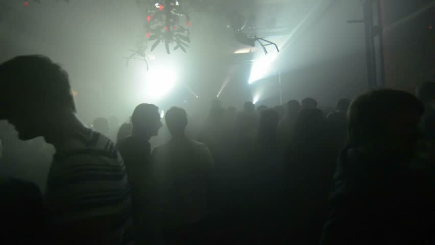 dance party. walking through live show. amazing pov shot passing through a silhouetted crowd.