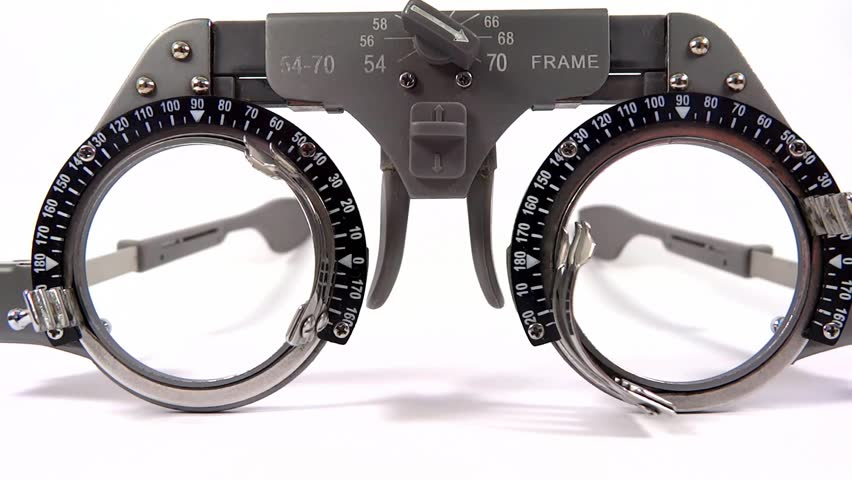 Spectacles used for eyesight tests with various lenses and occlusion on white background