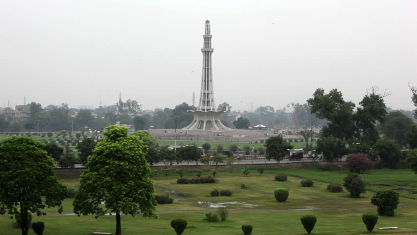 Minar-e-Pakistan, is a public monument located in Iqbal Park in Lahore, Pakistan. The tower was constructed during the 1960s. | Shutterstock HD Video #6021224