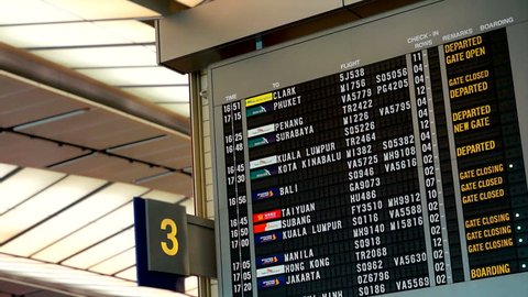 SINGAPORE, ASIA - 17 NOVEMBER 2013: Flight information at a timetable at Changi airport in Singapore, Asia