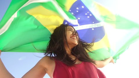 Cheerful girl from brazil with brazilian flag in slow motion