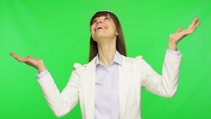 business woman hold hands palms up catch copy space falling down from above wear white suit, businesswoman smile over green screen chroma key background