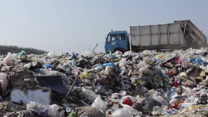 34/35 Garbage truck transported and disposed trash on the landfill.Vehicle transporting garbage to waste.Truck disposing of garbage at dump.Ecological disaster.Tracking shot.Footage available in 25fps