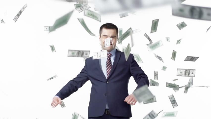 Man in jacket making winner gestures, dollars falling over him | Shutterstock HD Video #6071147
