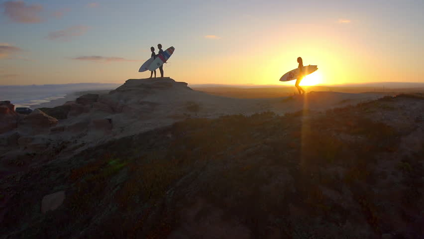 AERIAL: Surfers watching waves at sunset #6075434