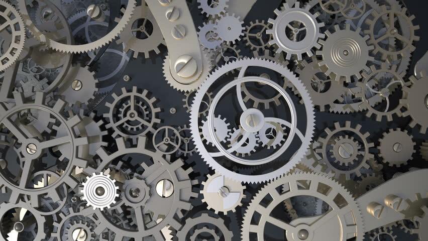Background with metal cogwheels a clockwork. Macro, extreme closeup