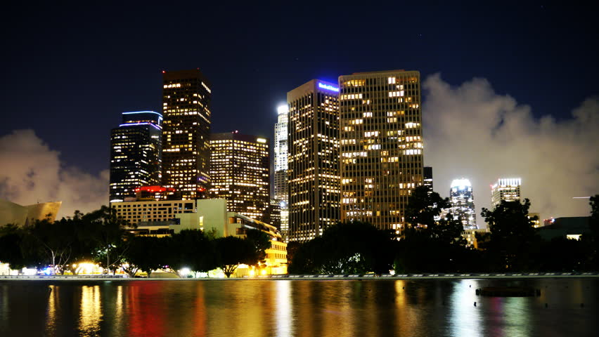 Time Lapse of Downtown Los Angeles with Reflection and Storm Clouds -Tilt Down-