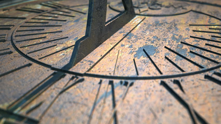 A macro closeup time-lapse of a camera panning across a metal sundial with time passing over a day #6110549