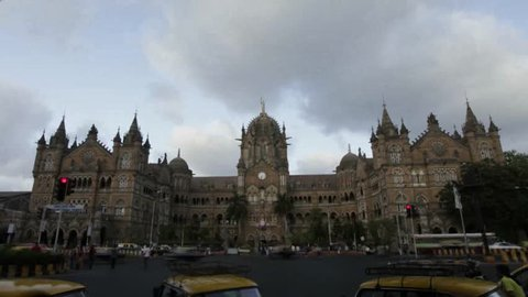 Time lapse shot of (V.T.) CST Station building   lit up at evening, Mumbai, Maharashtra, India.